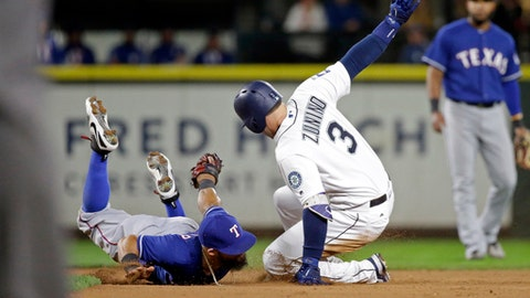 Texas Rangers second baseman Rougned Odor lands on his belly after swiping a tag at Seattle Mariners' Mike Zunino (3) at second base on Zinino's double during the eighth inning of a baseball game Wednesday, Sept. 20, 2017, in Seattle. (AP Photo/Elaine Thompson)