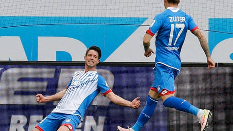 FILE - In this April 16, 2016 file photo Hoffenheim's Mark Uth, left, celebrates his side's winning goal during a German first division Bundesliga match between TSG 1899 Hoffenheim and Hertha BSC Berlin in Sinsheim, Germany. Uth's brilliant start to the season could yet earn the Hoffenheim forward a call-up for Germany before the World Cup next year. The 26-year-old scored again late Wednesday, Sept. 20, 2017 – in the second minute of injury time – to clinch a remarkable 3-2 win for his side at Mainz.  (AP Photo/Michael Probst, file)