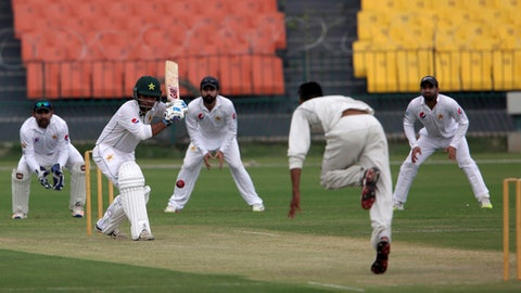 Pakistani cricket players play a practice match for the upcoming series, at Gaddafi Stadium in Lahore, Pakistan, Thursday, Sept. 21, 2017. Pakistan will play two-Test series against Sri Lanka in the United Arab Emirates that starts Sept. 28, 2017. (AP Photo/K.M. Chaudary)