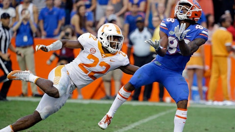 FILE -- In this Sept. 16, 2017 file photo, Florida wide receiver Tyrie Cleveland, right, catches the game winning 63-yard touchdown pass in front of Tennessee defensive back Micah Abernathy (22) as time expired in the fourth quarter of an NCAA college football game in Gainesville, Fla. Florida won 26-20. One year after injuries and big plays made it tough for Tennessee to stop anyone late in the season, the Volunteers find themselves again dealing with those same issues. The stunning finish to the loss to Florida wounded the pride of a defense that already had taken plenty of lumps this season. (AP Photo/John Raoux, File)
