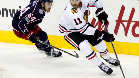 FILE - In this Sept. 19, 2017, file photo, Chicago Blackhawks defenseman Cody Franson, right, controls the puck against Columbus Blue Jackets forward David Kampf, of the Czech Republic, during the third period of a preseason NHL hockey game in Columbus, Ohio. Consider a team like the Chicago has over $45 million committed to its top six players, there wasn't space available to offer Franson a guaranteed contract despite the 30-year-old defenseman having 205 points in 527 games. (AP Photo/Paul Vernon, File)