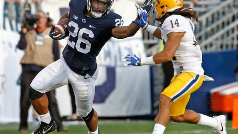 FILE - In this Saturday, Sept. 9, 2017, file photo, Penn State's Saquon Barkley (26) looks to stiff arm Pittsburgh's Avonte Maddox (14) during the second half of an NCAA college football game in State College, Pa. The fourth-ranked Nittany Lions (3-0) open Big Ten play against one of their most vexing conference rivals on Saturday, Iowa.  (AP Photo/Chris Knight, File)