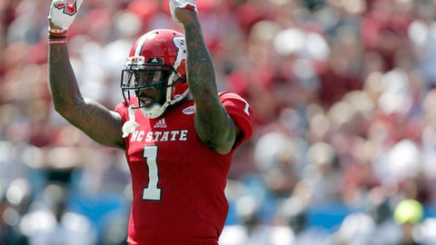 FILE - In this Sept. 2, 2017, file photo, North Carolina State's Jaylen Samuels (1) tries to raise the crowd noise against South Carolina during the first half of an NCAA football game in Charlotte, N.C. Florida State has one of the nation's most versatile defenders in Derwin James. On Saturday, James and the Seminoles' defense will go against what many consider the Atlantic Coast Conference's most versatile offensive player in NC State's Samuels. (AP Photo/Bob Leverone, File)