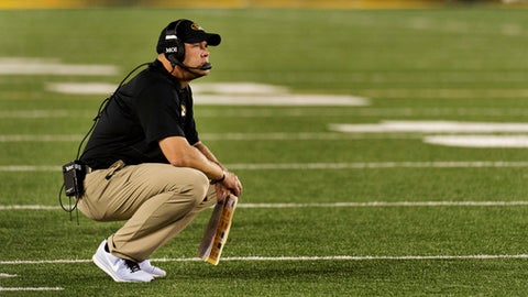 FILE - In this Sept. 9, 2017, file photo, Missouri head coach Barry Odom drops to his knees after South Carolina scored during the fourth quarter of an NCAA college football game in Columbia, Mo. Things were supposed to be better this season for Missouri under second-year coach Barry Odom. After struggling to defeat an FCS opponent in the opener and then back-to-back blowout losses, it's been more of the same for the woeful Tigers, who host No. 15 Auburn on Saturday. (AP Photo/L.G. Patterson, File)