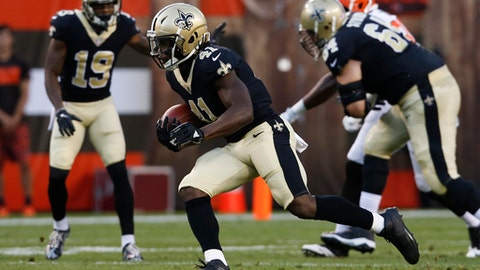 FILE - In this Aug. 10, 2017, file photo, New Orleans Saints running back Alvin Kamara runs the ball against the Cleveland Browns during the first half of an NFL preseason football game in Cleveland. Carolina's Christian McCaffrey and New Orleans' Alvin Kamara are in the infant stages of NFL careers that could very well run along parallel tracks in the same division for years to come. Their convergence off their pro football paths comes into focus on Sunday, when the Saints visit the Panthers in NFC South play. (AP Photo/Ron Schwane, File)