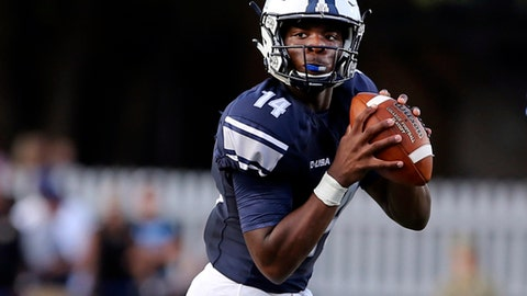 In this Saturday, Sept. 16, 2017 photo, Old Dominion quarterback Steven Williams Jr. looks downfield during an NCAA college football game against North Carolina in Norfolk, Va. Old Dominion coach Bobby Wilder was looking for an offensive spark when he sent 17-year-old freshman Steven Williams Jr. into last weekend's game against North Carolina. What he thinks he found instead is a quarterback.  (AP Photo/Jason Hirschfeld, File)