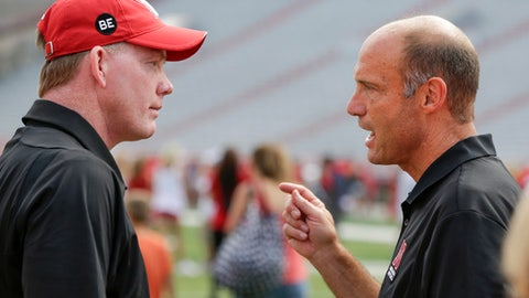"FILE - In this July 29, 2017, file photo, Nebraska football head coach Mike Riley, right, chats with athletic director Shawn Eichorst during fan day in Lincoln, Neb. Nebraska has fired Eichorst, on Thursday, Sept. 21, 2017, abruptly ending a five-year run and citing a failure to improve ""on-field performance"" by the Cornhuskers. (AP Photo/Nati Harnik)"