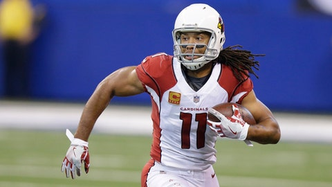 FILE - In this Sunday, Sept. 17, 2017, file photo, Arizona Cardinals' Larry Fitzgerald runs during the first half of an NFL football game against the Indianapolis Colts in Indianapolis. After a month on the road, the Arizona Cardinals finally get to play one at home, and it will be in the bright lights of Monday night against the Dallas Cowboys (AP Photo/Michael Conroy, File)