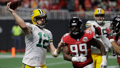 FILE - In this Sunday, Sept. 17, 2017, file photo, Green Bay Packers quarterback Aaron Rodgers (12) throws a pass against the Atlanta Falcons during the first of an NFL football game in Atlanta. Injuries that could leave the Packers without several key players may help the Cincinnati's chances of digging out from an 0-2 start. But, two-time NFL MVP quarterback Aaron Rodgers represents the great equalizer, capable of winning any game regardless of the circumstances. (AP Photo/David Goldman, File)