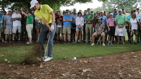 Jordan Spieth hits from the woods to the fifth green during the first round of the Tour Championship golf tournament at East Lake Golf Club in Atlanta, Thursday, Sept. 21, 2017. (Curtis Compton/Atlanta Journal-Constitution via AP)