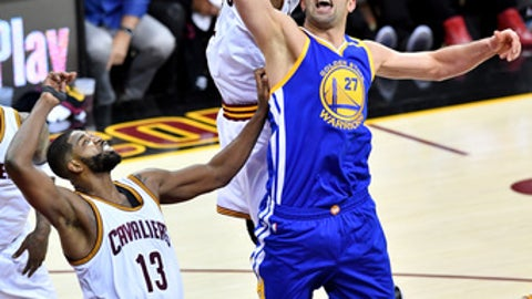 CLEVELAND, OH - JUNE 07: Kyrie Irving #2 of the Cleveland Cavaliers and Zaza Pachulia #27 of the Golden State Warriors compete for the ball in the second half in Game 3 of the 2017 NBA Finals at Quicken Loans Arena on June 7, 2017 in Cleveland, Ohio. NOTE TO USER: User expressly acknowledges and agrees that, by downloading and or using this photograph, User is consenting to the terms and conditions of the Getty Images License Agreement.  (Photo by Jason Miller/Getty Images)