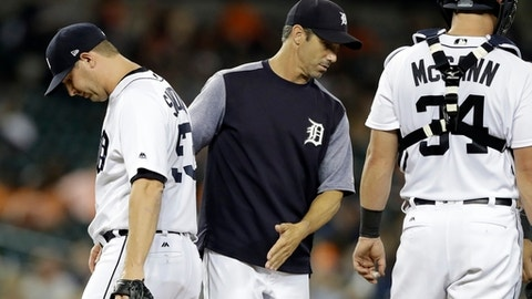 Detroit Tigers manager Brad Ausmus pulls relief pitcher Warwick Saupold during the fifth inning of a baseball game against the Minnesota Twins, Thursday, Sept. 21, 2017, in Detroit. (AP Photo/Carlos Osorio)