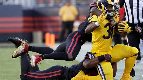 Los Angeles Rams running back Todd Gurley (30) is tackled by San Francisco 49ers cornerback Jimmie Ward, top left, and defensive end DeForest Buckner during the first half of an NFL football game in Santa Clara, Calif., Thursday, Sept. 21, 2017. (AP Photo/Marcio Jose Sanchez)