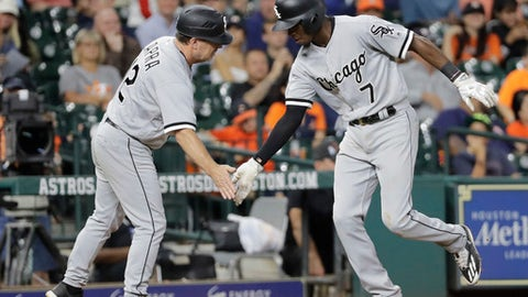 Chicago White Sox's Tim Anderson (7) is congratulated by third base coach Nick Capra after hitting a home run against the Houston Astros during the eighth inning of a baseball game Thursday, Sept. 21, 2017, in Houston. (AP Photo/David J. Phillip)