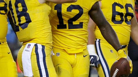 Los Angeles Rams wide receiver Sammy Watkins (12) is congratulated by Cooper Kupp (18) after scoring a touchdown against the San Francisco 49ers during the second half of an NFL football game in Santa Clara, Calif., Thursday, Sept. 21, 2017. (AP Photo/Ben Margot)