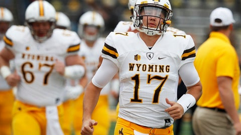 FILE - In this Saturday, Sept. 2, 2017, file photo, Wyoming quarterback Josh Allen (17) runs onto the field before an NCAA college football game against Iowa in Iowa City, Iowa. Allen had a long day against Iowa and it got even worse against Oregon. The Wyoming quarterback's two big chances to show off his prodigious talents were pretty much a flop, but make no mistake: Allen is still one of the most talented college quarterbacks in the country and a potential high draft pick. (AP Photo/Charlie Neibergall, File)
