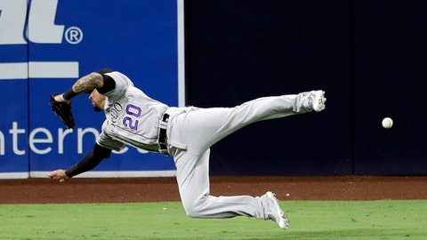 Colorado Rockies left fielder Ian Desmond can't reach a double by San Diego Padres' Austin Hedges during the seventh inning of a baseball game Thursday, Sept. 21, 2017, in San Diego. (AP Photo/Gregory Bull)