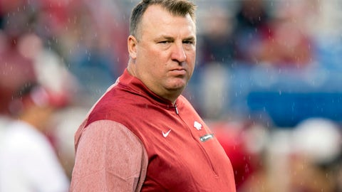 FILE - In this Aug. 31, 2017, file photo, Arkansas coach Bret Bielema walks across the field before the team's NCAA college football game against Florida A&M in Little Rock, Ark. Bielema has had his share of struggles in the Southeastern Conference since leaving Wisconsin following the 2012 season. None have frustrated Razorbacks fans quite as much as the school's recent woes against Texas A&M. (AP Photo/Gareth Patterson, File)