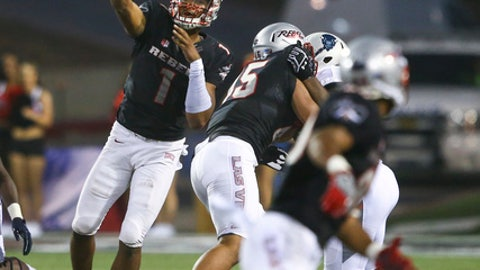 FILE - In this Sept. 2, 2017, file photo, UNLV quarterback Armani Rogers (1) throws a pass against Howard during an NCAA college football game, in Las Vegas. Rogers is just a redshirt freshman but is being hyped as the guy who will help lead a resurgence of UNLV football. UNLV plays Ohio State this week. (Chase Stevens/Las Vegas Review-Journal via AP, File)