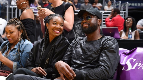 LOS ANGELES, CA - SEPTEMBER 1:  Actress Gabrielle Union with husband Dwyane Wade of the Chicago Bulls  attend the game between the Atlanta Dream and the Los Angeles Sparks on September 1, 2017 at the STAPLES Center in Los Angeles, California. NOTE TO USER: User expressly acknowledges and agrees that, by downloading and or using this photograph, user is consenting to the terms and conditions of the Getty Images License Agreement. Mandatory Copyright Notice: Copyright 2017 NBAE (Photos by Adam Pantozzi/NBAE via Getty Images)