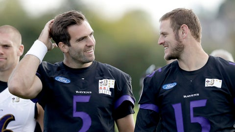 Baltimore Ravens first choice quarterback Joe Flacco, left, walks with quarterback Ryan Mallett as they leave the field at the end of a practice session at London Irish training ground in London, England, Friday, Sept. 22, 2017. Baltimore Ravens are due to play Jacksonville Jaguars at Wembley stadium in London on Sunday in a regular season NFL game. (AP Photo/Matt Dunham)