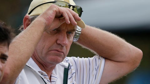 FILE - In this Oct. 5, 2013, file photo, International team captain Nick Price adjust his hat during the foursomes matches at the Presidents Cup golf matches at Muirfield Village Golf Club in Dublin, Ohio. Price will will captain the International team in the upcoming Presidents Cup matches at Liberty National Golf Club in Jersey City, N.J.  (AP Photo/Darron Cummings, File)