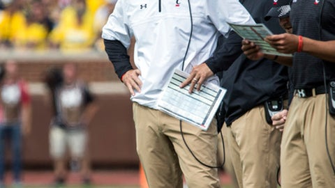 FILE - In this Saturday, Sept. 9, 2017 file photo, Cincinnati head coach Luke Fickell, left, looks on from the sideline in the fourth quarter of an NCAA college football game against Michigan in Ann Arbor, Mich. Navy and Cincinnati will meet for the first time Saturday, Sept. 23, 2017 as American Athletic Conference opponents. Perhaps more notable, it's the first game between the teams since 1956. (AP Photo/Tony Ding, File)