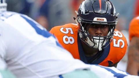FILE - In this Sunday, Sept. 17, 2017, file photo, Denver Broncos outside linebacker Von Miller eyes Dallas Cowboys quarterback Dak Prescott during the first half of an NFL football game in Denver. Miller gets the top billing in The Associated Press rankings of the NFL's best outside linebackers. Miller received nine of a possible 11 first-place votes to easily outdistance the field.  (AP Photo/Jack Dempsey, File)