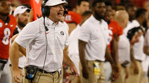 FILE - In this Sept. 16, 2017, file photo, Georgia coach Kirby Smart reacts on the sideline in the second half of an NCAA college football game against Samford in Athens, Ga. In a game between unfamiliar rivals sharing little beyond a nickname, No. 11 Georgia hosts No. 17 Mississippi in an early season showdown that will help shake out the balance of the power in the SEC. (Joshua L. Jones/Athens Banner-Herald via AP, File)