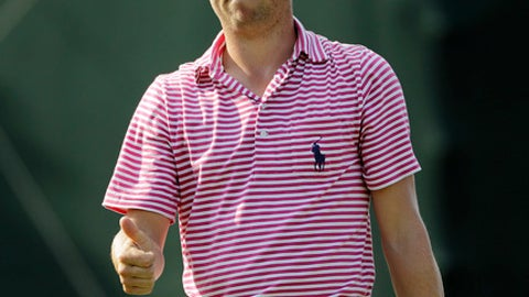 Justin Thomas gestures as he prepares to putt on the 17th green during the second round of the Tour Championship golf tournament at East Lake Golf Club in Atlanta, Friday, Sept. 22, 2017. (AP Photo/David Goldman)