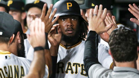 Pittsburgh Pirates' Josh Bell, center, is greeted by teammates in the dugout after scoring during the fourth inning of a baseball game against the St. Louis Cardinals, Friday, Sept. 22, 2017, in Pittsburgh. (AP Photo/Keith Srakocic)