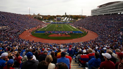 FILE- In this Oct. 24, 2009, file photo, a full house at Kansas Memorial Stadium watches the first half of an NCAA college football game between Oklahoma and Kansas in Lawrence, Kan. The university revealed, during a dinner Friday night, Sept. 22, 2017, for some of its most influential donors, a $350 million plan to overhaul its football stadium and improve other facilities. (AP Photo/Orlin Wagner, File)