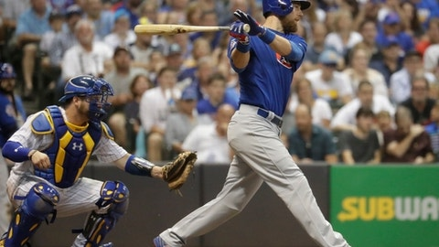 Chicago Cubs' Ben Zobrist hits a two-run scoring single during the fifth inning of a baseball game against the Milwaukee Brewers Friday, Sept. 22, 2017, in Milwaukee. (AP Photo/Morry Gash)