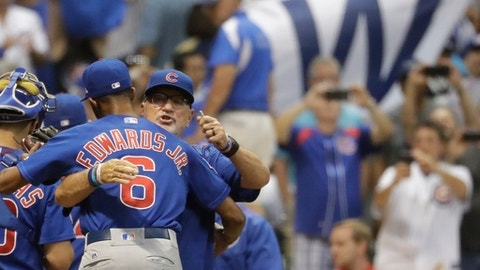 Chicago Cubs manager Joe Maddon hugs Carl Edwards Jr. after a baseball game against the Milwaukee Brewers Friday, Sept. 22, 2017, in Milwaukee. The Cubs won 5-4. (AP Photo/Morry Gash)