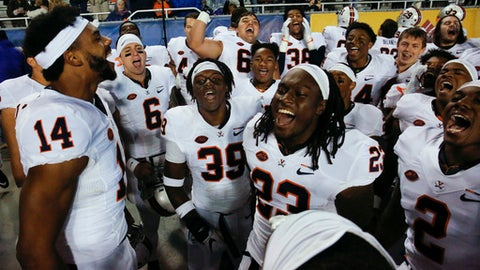 Virginia wide receivers Andre Levrone (14) and Warren Craft (23) celebrate with teammates after their 42-23 win over Boise State in an NCAA college football game in Boise, Idaho, Friday, Sept. 22, 2017. (AP Photo/Otto Kitsinger)
