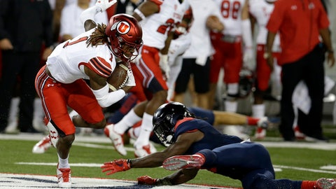 Utah's Boobie Hobbs (1) avoids the tackle from Arizona's Demetrius Flannigan-Fowles on a punt return during the first half of an NCAA college football game, Friday, Sept. 22, 2017, in Tucson, Ariz. (AP Photo/Rick Scuteri)
