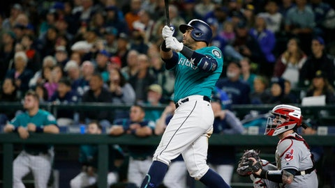 Seattle Mariners' Nelson Cruz watches his walk-off home run, which scored Robinson Cano, in the ninth inning of a baseball game against the Cleveland Indians, Friday, Sept. 22, 2017, in Seattle. The Mariners won 3-1. (AP Photo/Ted S. Warren)