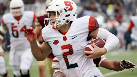 FILE - In this Oct. 22, 2016, file photo, Syracuse quarterback Eric Dungey (2) rushes with the ball ahead of a Boston College defender during the first half of an NCAA college football game in Boston. Syracuse quarterback Eric Dungey and cousin Ryan, a motocross champion, share a toughness that's in the family genes. Ryan figures he's broke at least 10 bones racing and Eric has excelled at Syracuse despite at least one concussion. (AP Photo/Mary Schwalm, File)