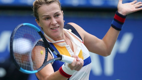 Anastasia Pavlyuchenkova of Russia returns a shot to Angelique Kerber of Germany during their semifinal match of the Pan Pacific Open tennis tournament in Tokyo, Saturday, Sept. 23, 2017. (AP Photo/Koji Sasahara)