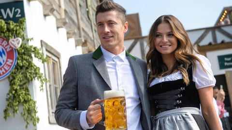 Munich soccer player Robert Lewandowski and his wife Anna Lewandowska  arrive  at the Oktoberfest in Munich, Germany, Saturday, Sept. 23, 2017. The Bayern Munich squad visited the traditional beer festival on Saturday. (Matthias Balk/dpa via AP)