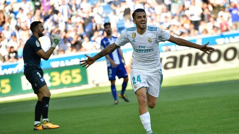 Real Madrid's Dani Ceballos celebrates his second goal after scoring against Alaves during the Spanish La Liga soccer match between Real Madrid and Alaves, at Mendizorra stadium, in Vitoria, northern Spain, Saturday, Sept.23, 2017. (AP Photo/Alvaro Barrientos)