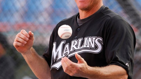 FILE - In this Sept. 21, 2011, file photo, former Florida Marlins player Jeff Conine tosses a ball during batting-practice before a baseball game between the Marlins and Atlanta Braves in Miami. Conine, who goes by the nickname Mr. Marlin, is part of the purge of Miami Marlins executives before the sale of the team to Derek Jeter's investment group. (AP Photo/Lynne Sladky, File)