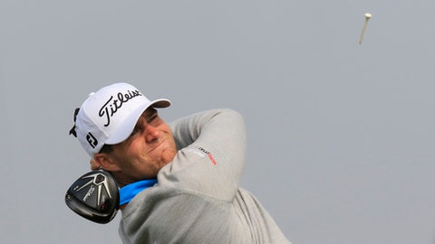 Lucas Bjerregaard of Denmark watches his shot on the 7th hole during the third round of the BMW Masters golf tournament at the Lake Malaren Golf Club in Shanghai, China, Saturday, Nov. 14, 2015. (AP Photo)