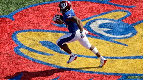 Kansas running back Khalil Herbert (10) runs the ball to score a touchdown during the first half of an NCAA college football game against the West Virginia, Saturday, Sept. 23, 2017, in Lawrence, Kan. (AP Photo/Charlie Riedel)