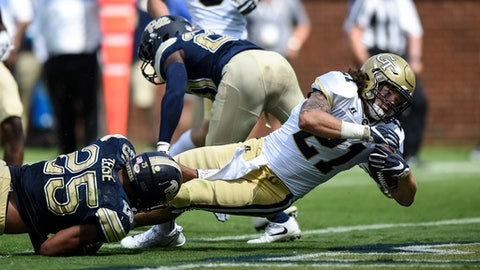 Georgia Tech running back Quaide Weimerskirch (21) falls into the end zone for a touchdown during the second half of an NCAA college football game, Saturday, Sept. 23, 2017, in Atlanta. (AP Photo/Jon Barash)