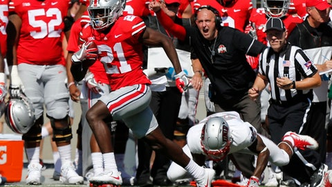 Ohio State receiver Parris Campbell, left, escapes the grasp of UNLV linebacker Gabe McCoy on his way to scoring a touchdown during the first half of an NCAA college football game Saturday, Sept. 23, 2017, in Columbus, Ohio. (AP Photo/Jay LaPrete)