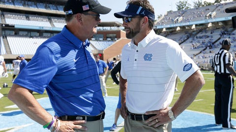 Duke coach David Cutcliffe, left, and North Carolina coach Larry Fedora speak prior to an NCAA college football game in Chapel Hill, N.C., Saturday, Sept. 23, 2017. (AP Photo/Gerry Broome)