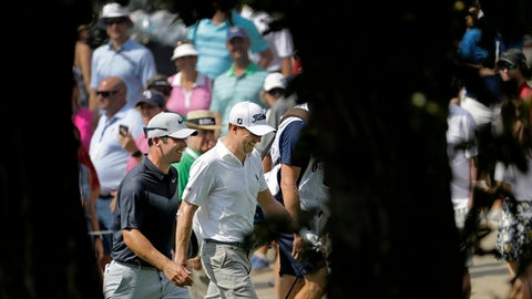 Paul Casey of England, left, and Justin Thomas walk up the fourth fairway together during the third round of the Tour Championship golf tournament at East Lake Golf Club in Atlanta, Saturday, Sept. 23, 2017. (AP Photo/David Goldman)