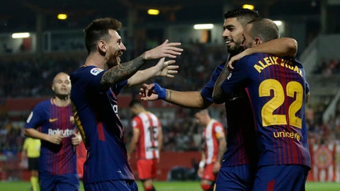 FC Barcelona's Lionel Messi, Luis Suarez, center, and Aleix Vidal celebrate a goal during the Spanish La Liga soccer match between Girona and FC Barcelona at the Montilivi stadium in Girona, Spain, Saturday, Sept. 23, 2017. (AP Photo/Manu Fernandez)