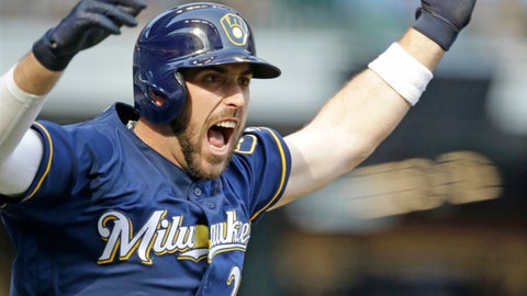 Milwaukee Brewers' Travis Shaw reacts after his two-run game winning home run against the Chicago Cubs during the 10th inning of a baseball game Saturday, Sept. 23, 2017, in Milwaukee. The Brewers won 4-3 in 10 innings. (AP Photo/Jeffrey Phelps)